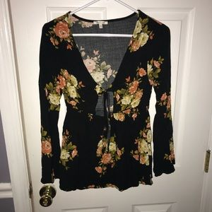 Black long sleeve floral peplum top